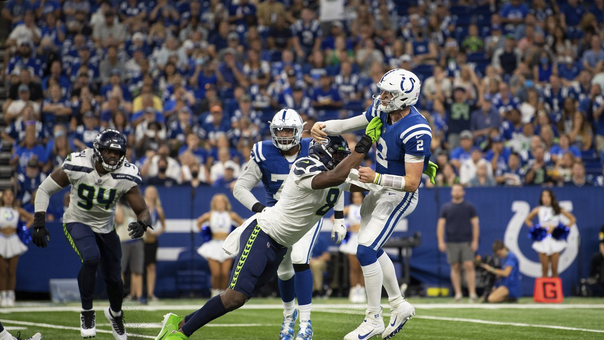 Seattle Seahawks defensive end Carlos Dunlap II (8) gets pressure on Indianapolis Colts...