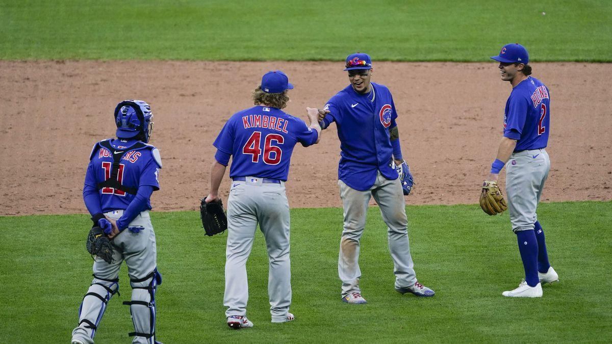 Chicago Cubs relief pitcher Craig Kimbrel (46) and teammates celebrate at the conclusion of a...