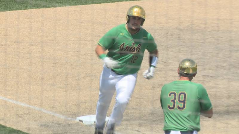 Niko Kavadas rounds third after hitting his second home run of the afternoon against Central...