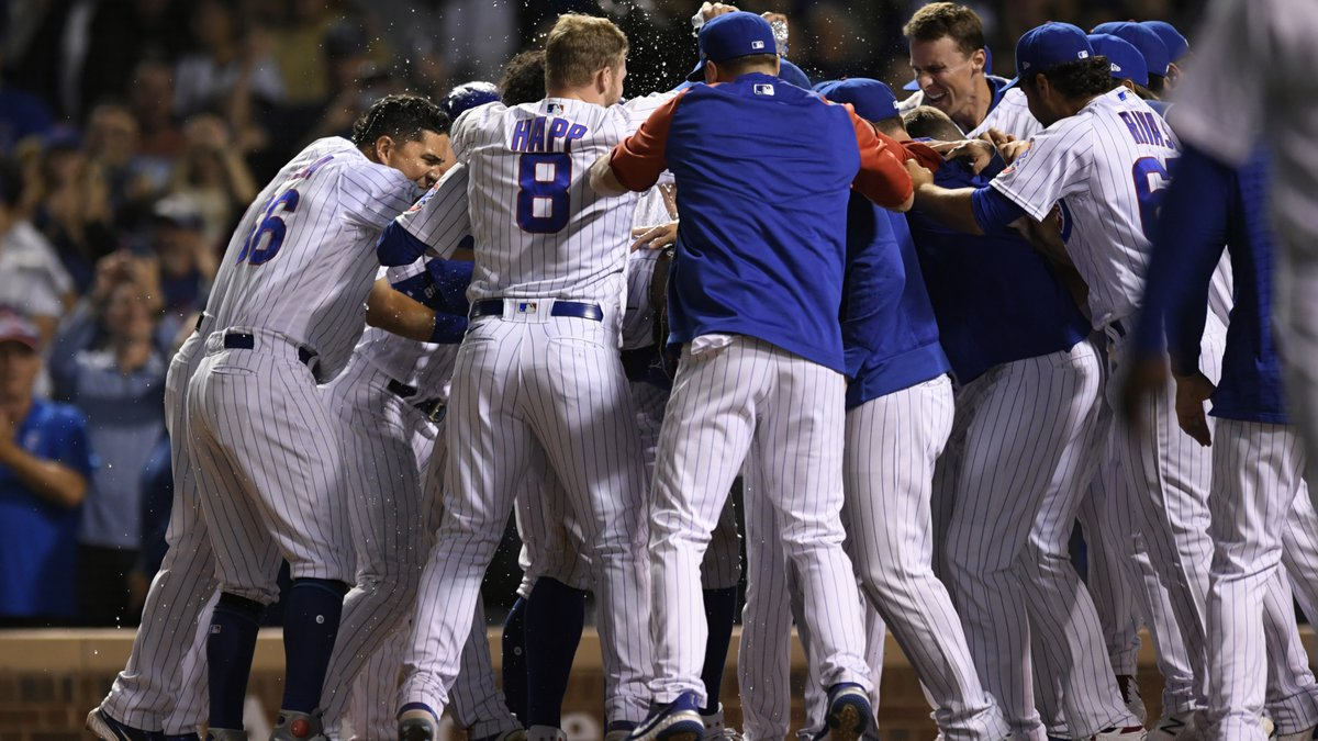 Chicago Cubs celebrate at home plate after Jason Heyward hit a game-ending, three-run home run...