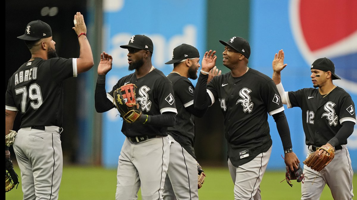The White Sox celebrate after clinching the American League title after defeating the Cleveland...