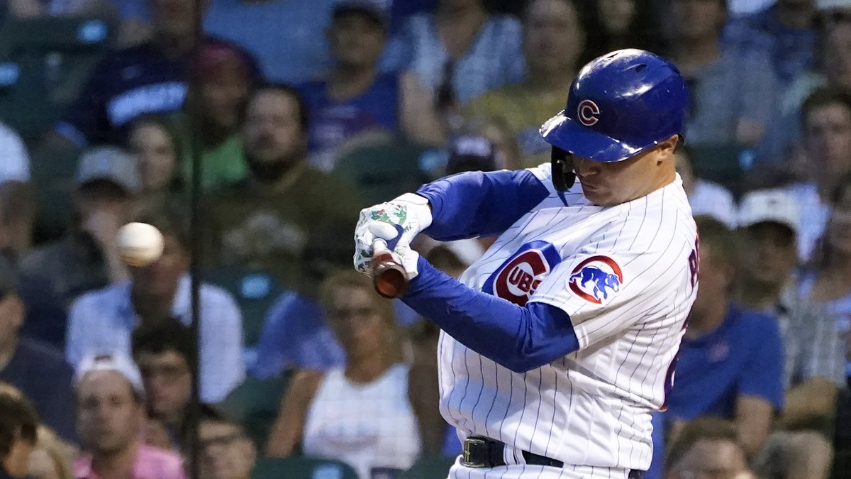 Chicago Cubs' Joc Pederson hits an RBI double off Philadelphia Phillies starting pitcher Aaron...