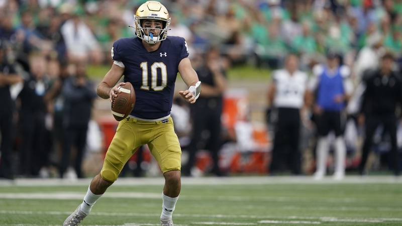 Notre Dame quarterback Drew Pyne (10) runs during the second half of an NCAA college football...