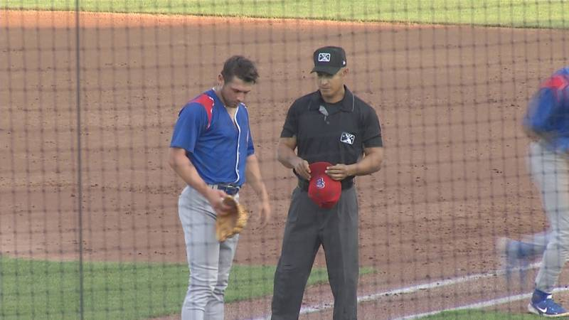 South Bend Cubs pitcher Ryan Jensen gets his hat checked after the first inning in a game...