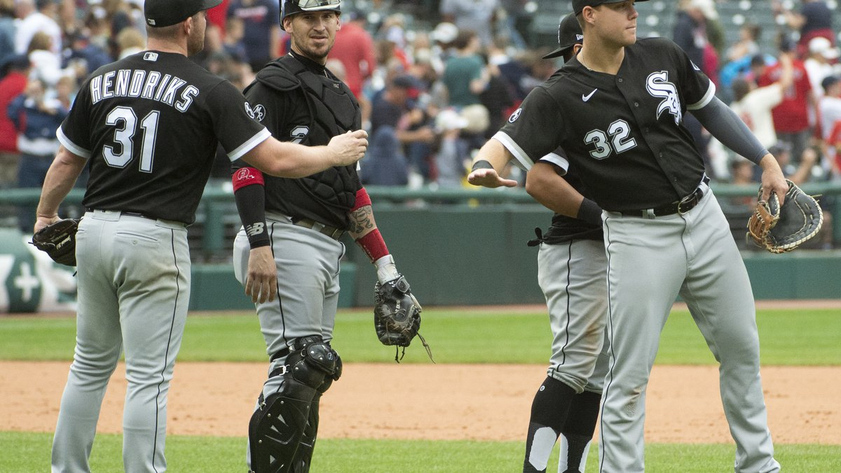 Chicago White Sox relief pitcher Liam Hendriks is congratulated by Gavin Sheets (32) as catcher...