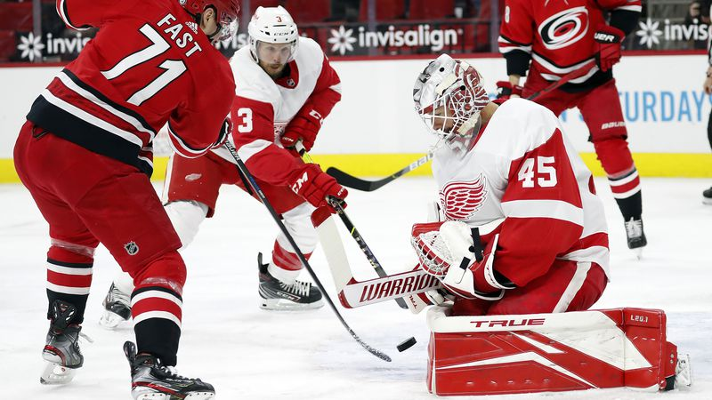 Detroit Red Wings goaltender Jonathan Bernier (45) blocks the shot of Carolina Hurricanes'...