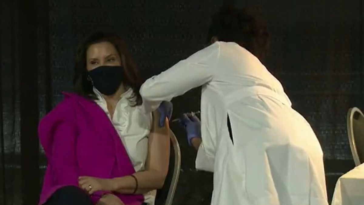 Gov. Gretchen Whitmer gets the COVID-19 vaccine from Dr. Joneigh Khaldun, who is Michigan's...