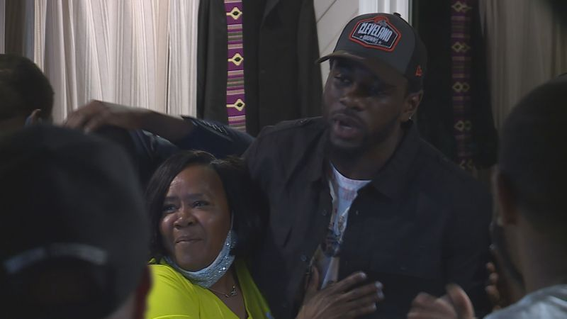 Jeremiah Owusu-Koramoah celebrates with his family after being selected with the 52nd overall...