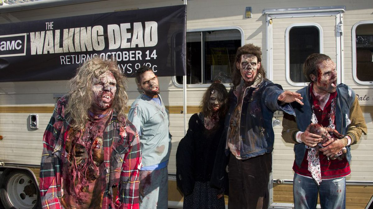 """Zombies are seen in front of the Winnebago from the AMC show """"The Walking..."""