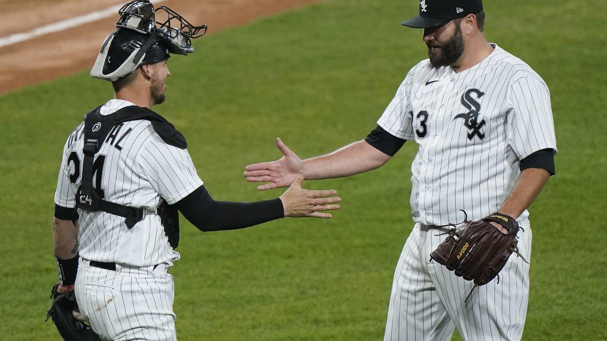Chicago White Sox starting pitcher Lance Lynn, right, celebrates with catcher Yasmani Grandal...