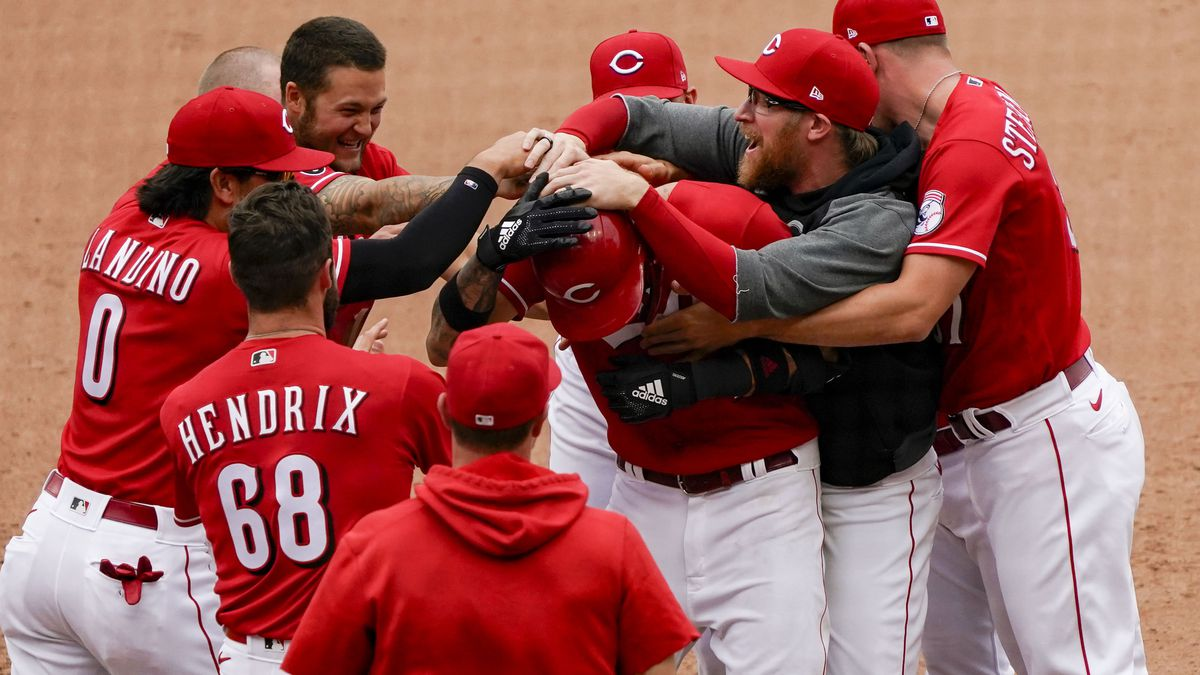 Cincinnati Reds' Nick Castellanos (2) celebrates with teammates after hitting a walk-off RBI...