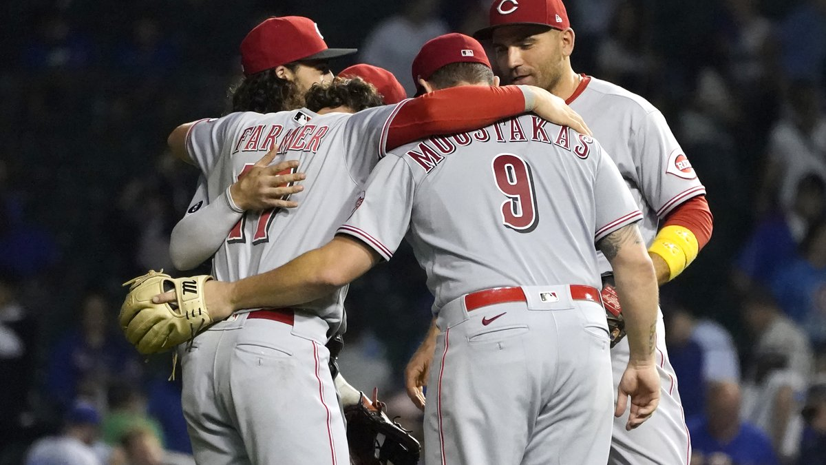 Cincinnati Reds infielders, from left, Jonathan India, Kyle Farmer, Mike Moustakas and Joey...