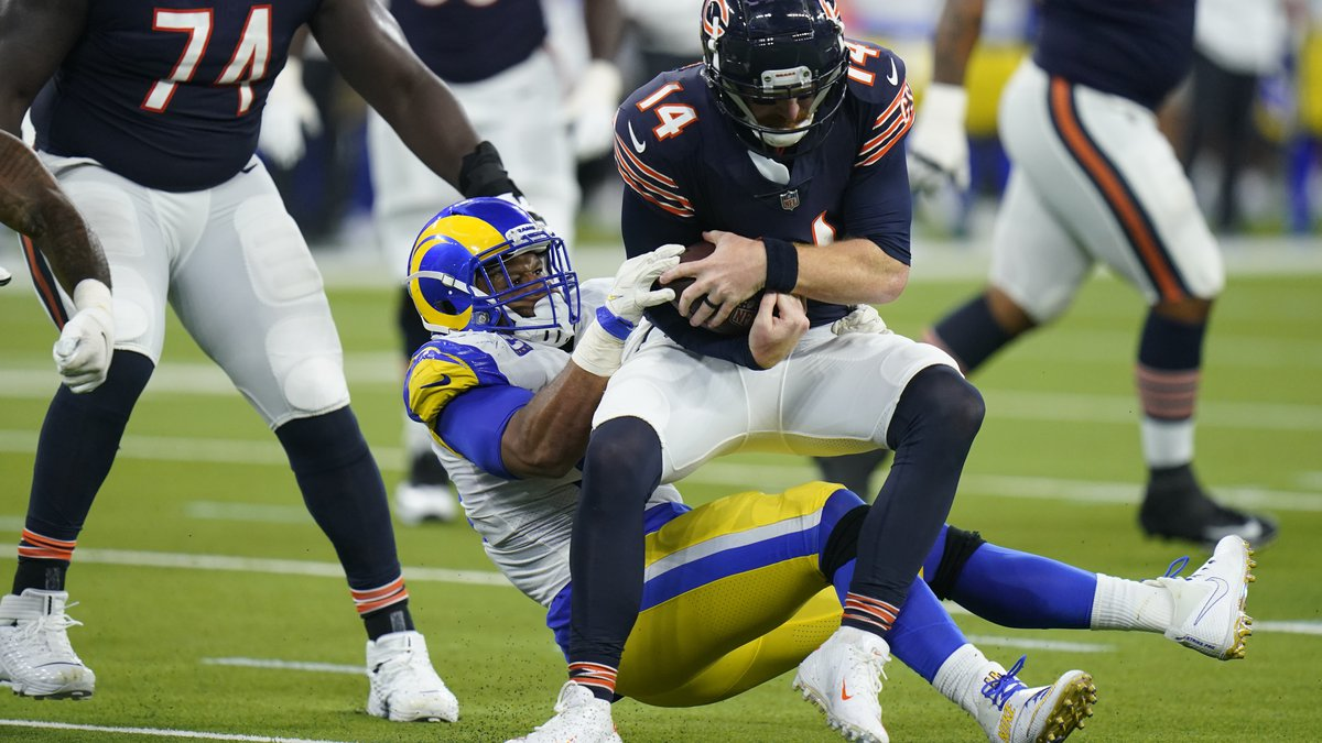 Chicago Bears quarterback Andy Dalton is hauled down by Los Angeles Rams defensive end Aaron...