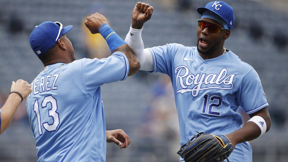 Kansas City Royals' Salvador Perez (13) and Jorge Soler (12) celebrate at the end of a baseball...