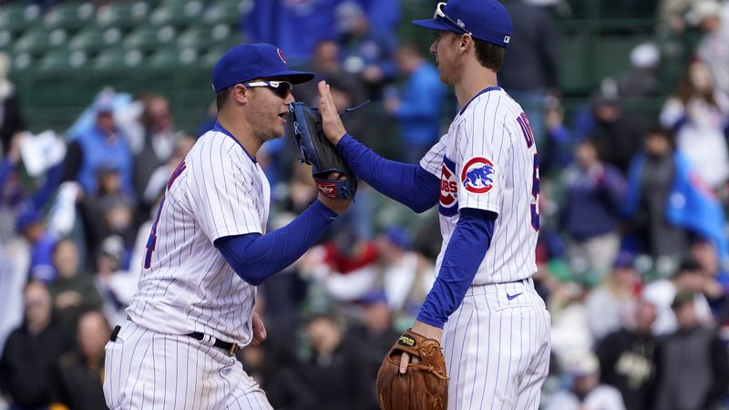 Chicago Cubs' Joc Pederson, left, and Matt Duffy celebrate their win over the Pittsburgh...