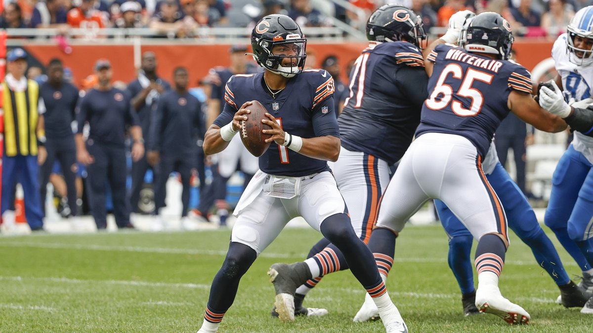 Chicago Bears quarterback Justin Fields (1) looks to pass the ball against the Detroit Lions...