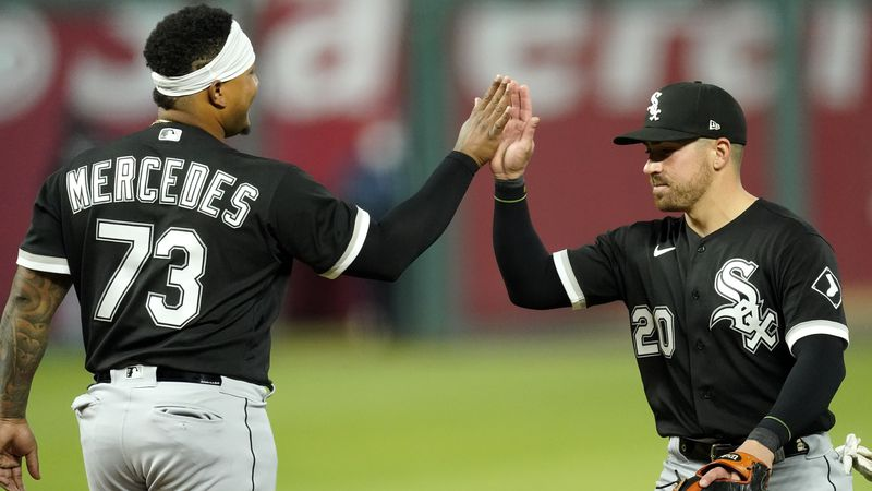 Chicago White Sox catcher Yermin Mercedes and second baseman Danny Mendick (20) celebrate after...