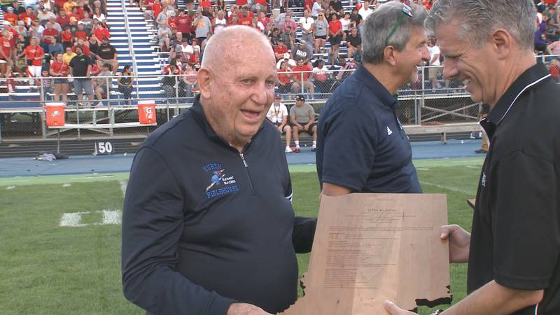 He led to the Blue Blazers to two football state titles and one IHSAA track championship.