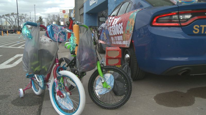 Officers in Stevensville and Niles greeted shoppers outside Meijer and Walmart to see how many...