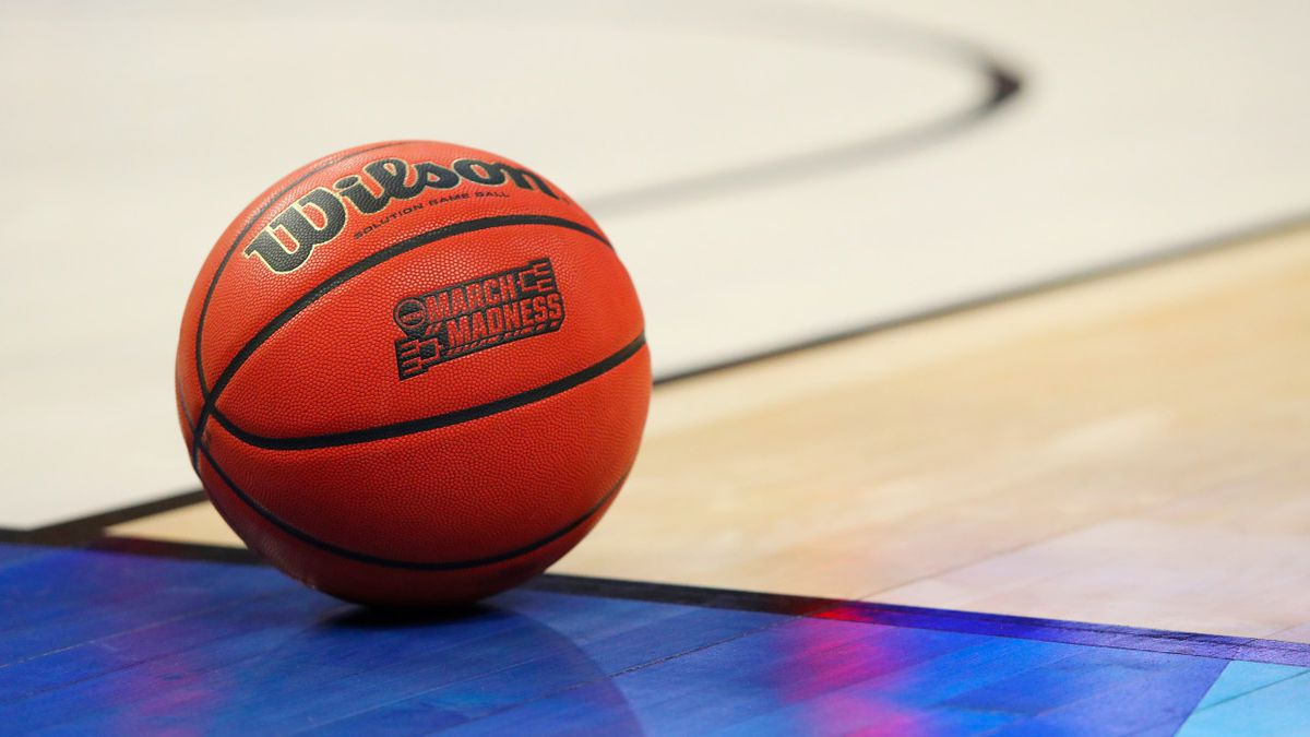 FILE -- In this March 18, 2017, file photo, an official game ball with the March Madness logo...