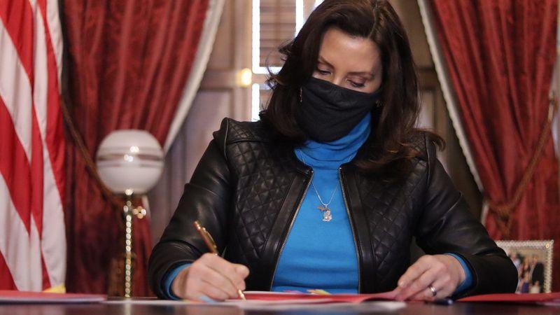Gov. Gretchen Whitmer signed a coronavirus relief bill on Dec. 29, 2020.