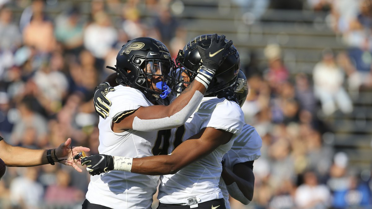 Purdue wide receiver Mershawn Rice, left, celebrates a touchdown with wide receiver Milton...