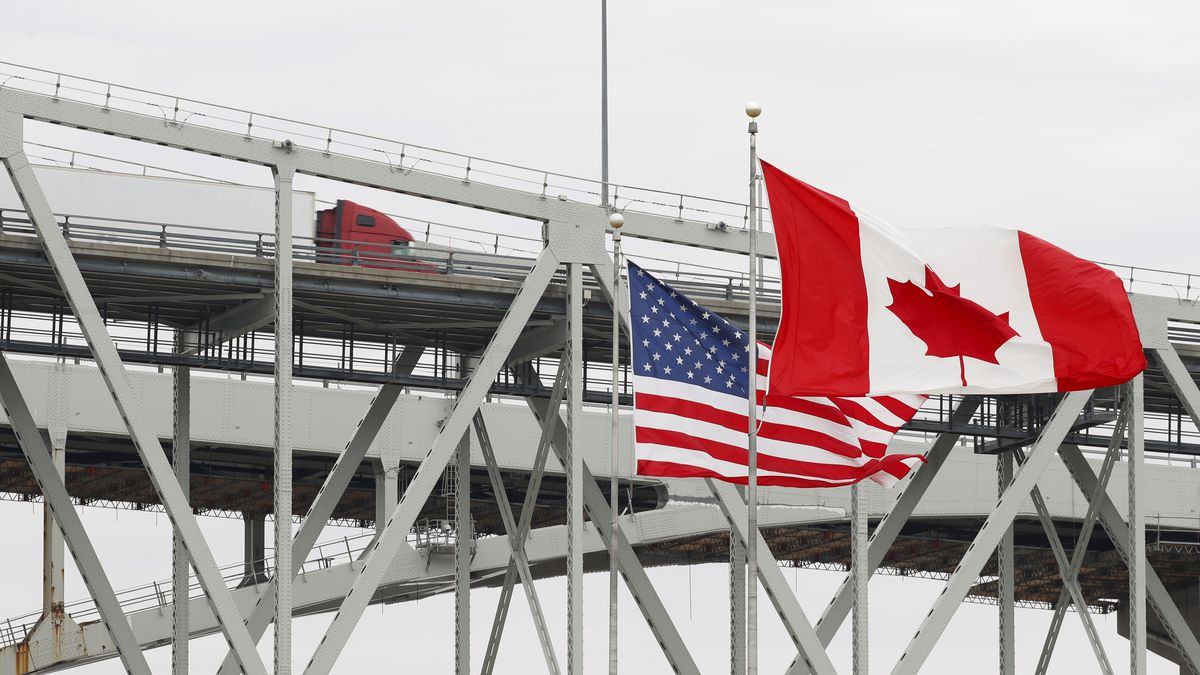 """A truck crosses the Blue Water Bridge into Port Huron, Mich., from Sarnia, Ontario, Canada, Wednesday, March 18, 2020. The Canada-U.S. border will be closed to non-essential traffic in both directions """"by mutual consent,"""" the leaders of both countries confirmed Wednesday as efforts across the continent to contain COVID-19."""