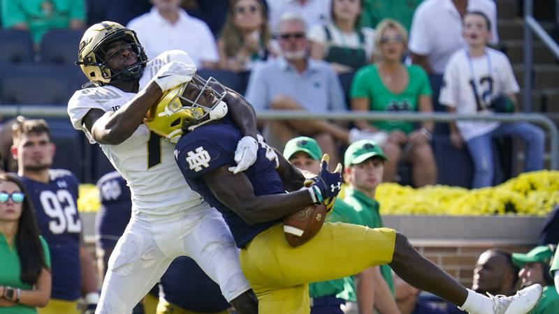 Purdue cornerback Jamari Brown (7) breaks up a pass to Notre Dame wide receiver Kevin Austin...