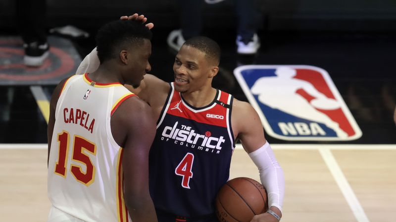Washington Wizards' Russell Westbrook (4) is congratulated by Atlanta Hawks' Clint Capela at...