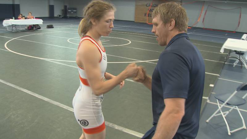 Sarah Hildebrandt and Brad Harper do their secret handshake before a simulated Olympic match in...