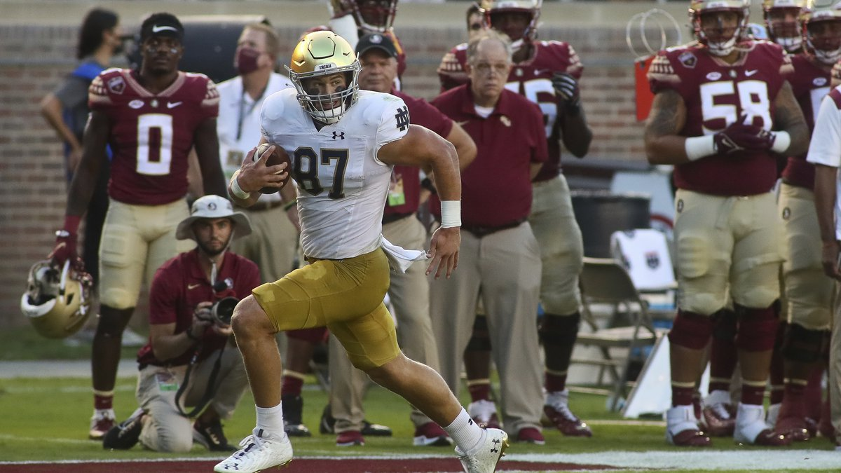 Notre Dame tight end Michael Mayer (87) runs past the Florida State sideline for a touchdown in...
