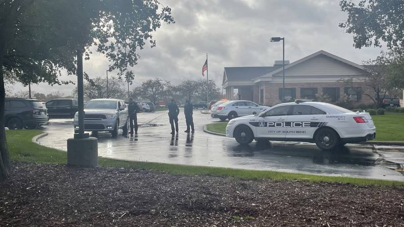 Police say they have apprehended the suspect in a Monday afternoon robbery of First Source Bank...