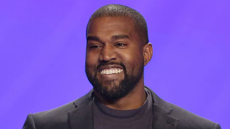 FILE - In this Nov. 17, 2019 file photo, Kanye West appears on stage during a service at...