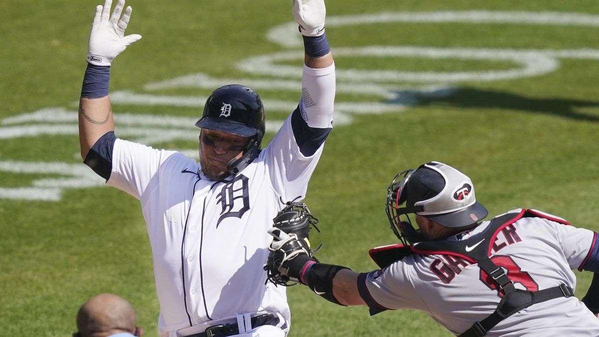 Detroit Tigers' Miguel Cabrera is tagged out by Minnesota Twins catcher Mitch Garver (8) as he...