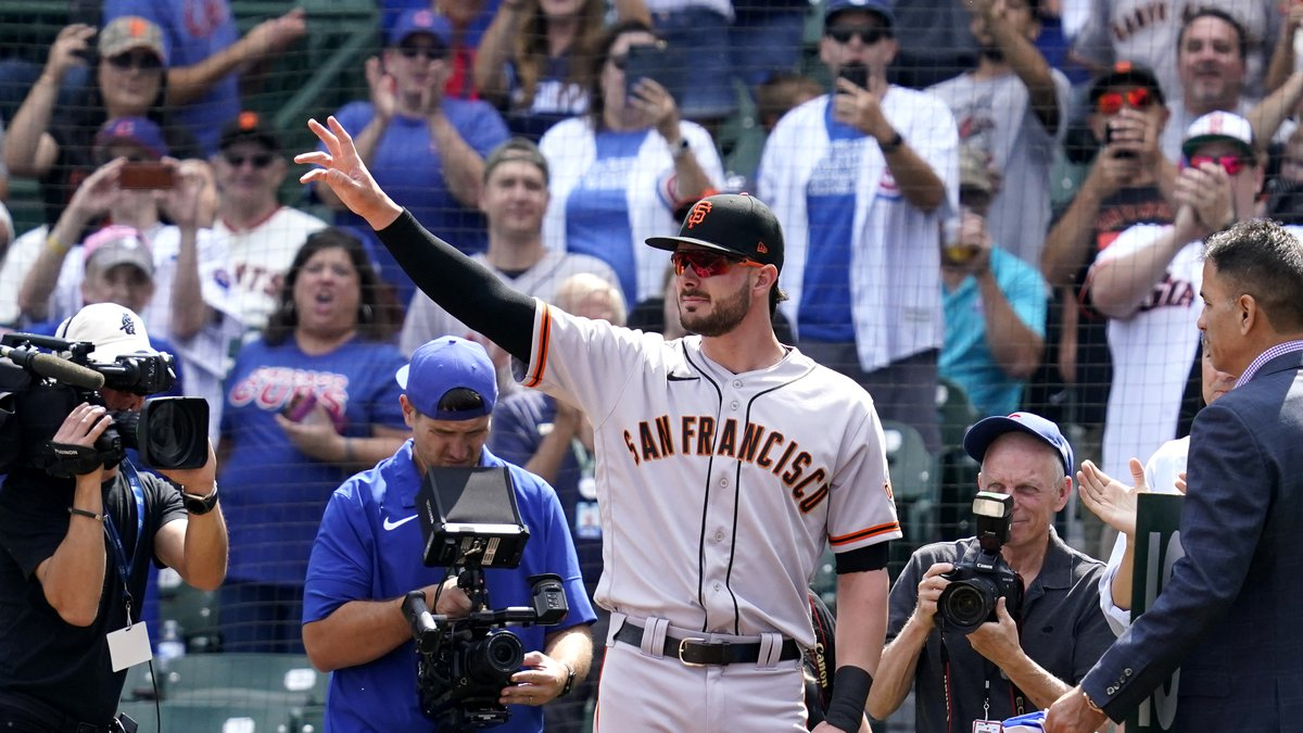 San Francisco Giants' Kris Bryant greets Chicago Cubs fans before a baseball game in Chicago,...