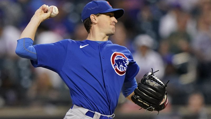 Chicago Cubs starting pitcher Kyle Hendricks winds up during the fifth inning of the team's...