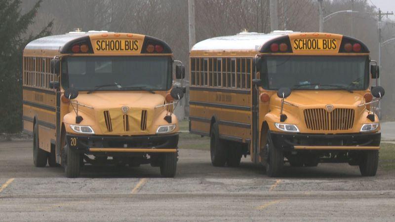John Glenn Schools busses parked outside