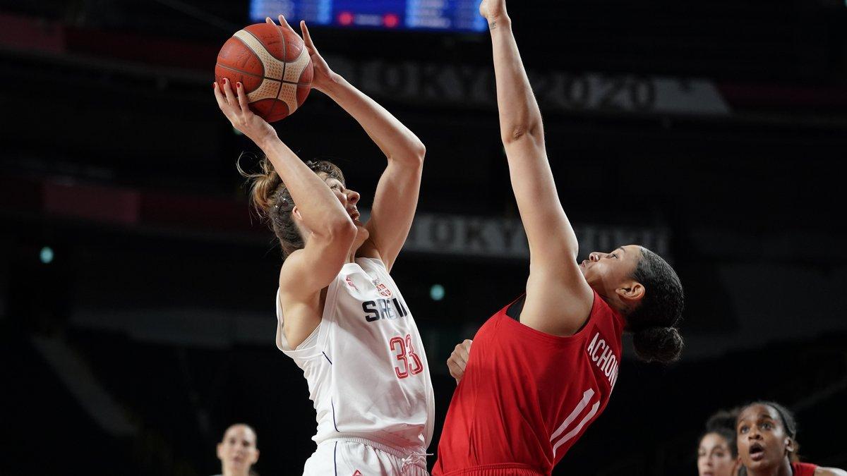 Serbia's Tina Krajisnik (33) shoots over Canada's Natalie Achonwa (11) during a women's...