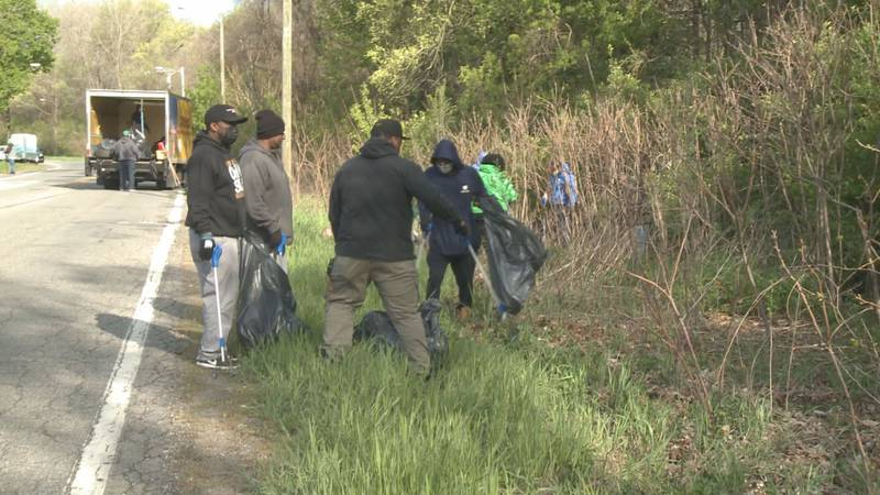 Volunteers and organizers worked together to pick up garbage from the neighborhood surrounding...