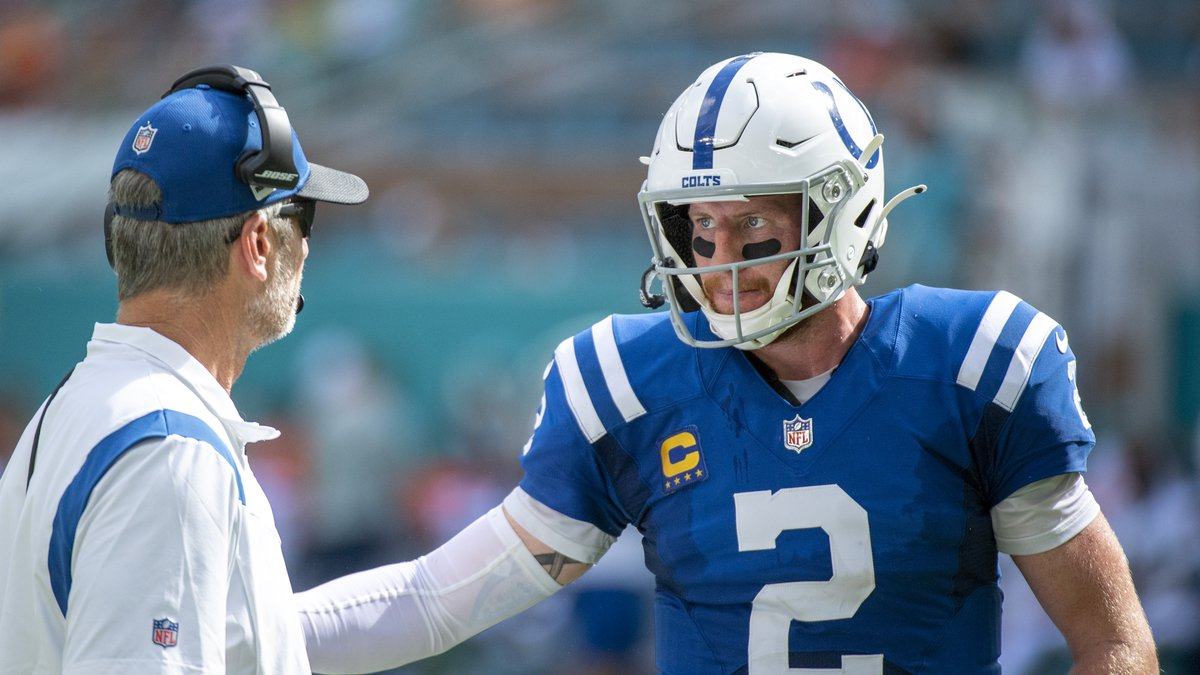 Indianapolis Colts quarterback Carson Wentz (2) and Indianapolis Colts head coach Frank Reich...