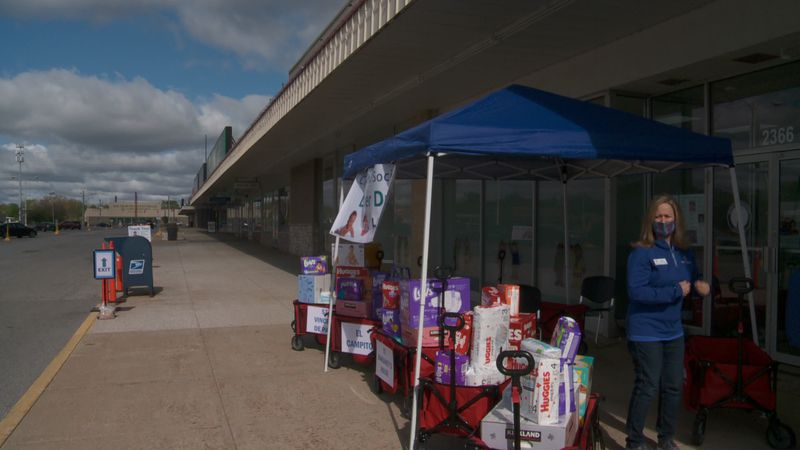 People were able to drop off diapers in front of the Town and Country Shopping Center in...