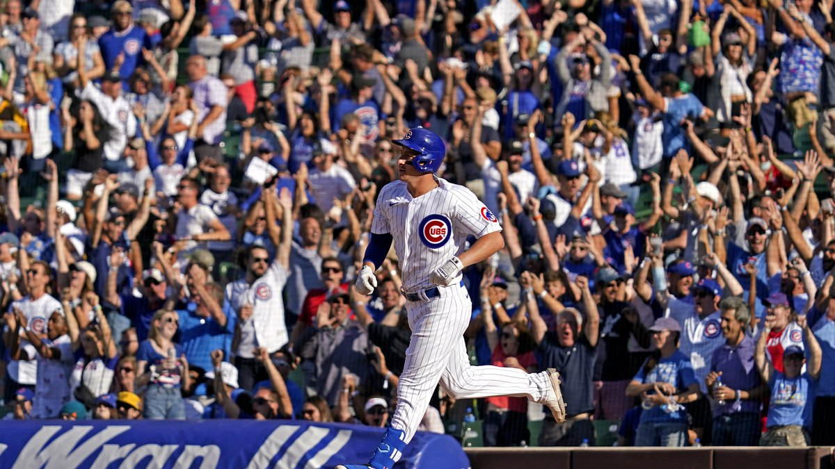 Chicago Cubs' Frank Schwindel rounds the bases after hitting a grand slam during the seventh...