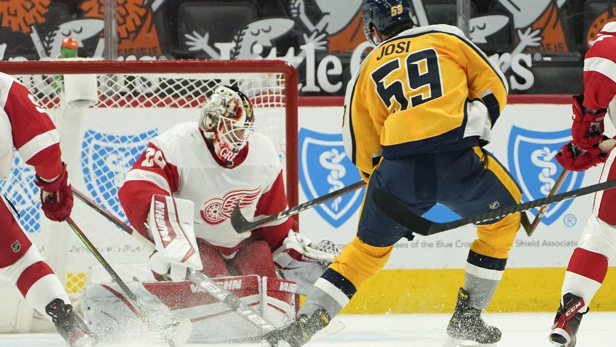 Detroit Red Wings goaltender Thomas Greiss (29) stops a Nashville Predators defenseman Roman...
