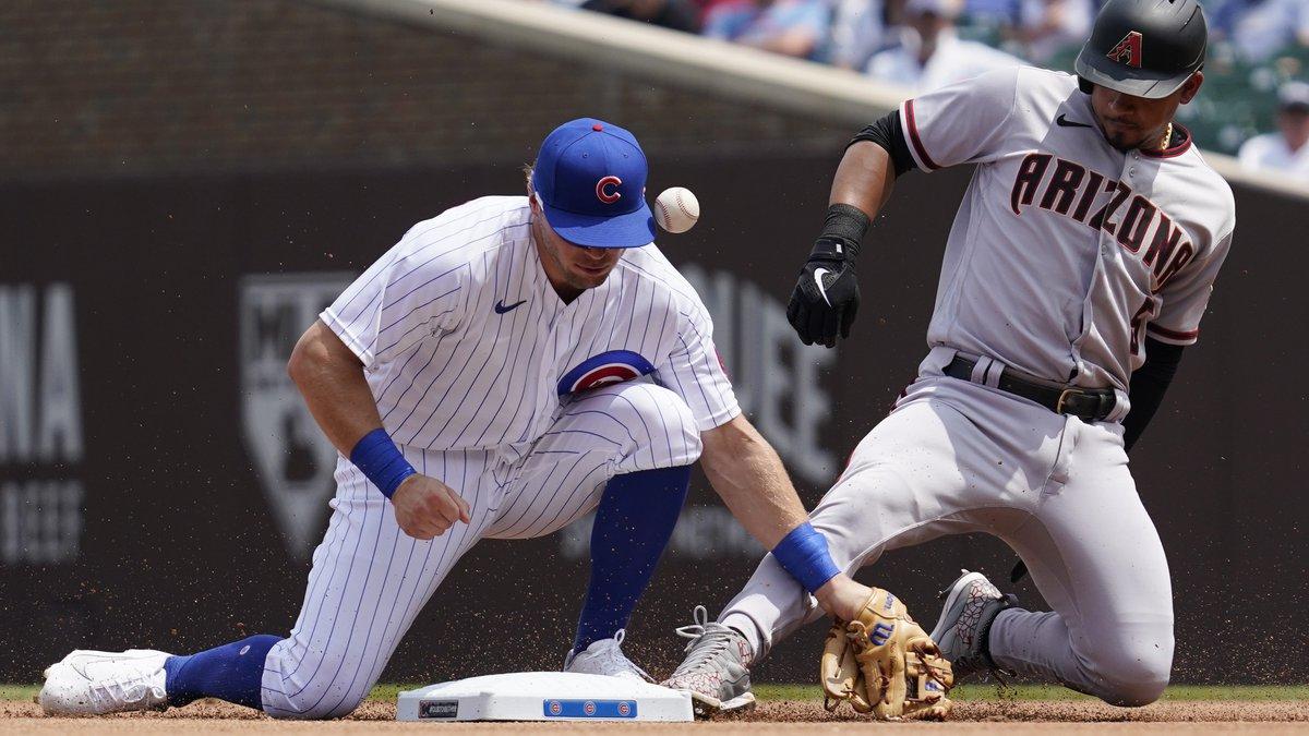 Arizona Diamondbacks' Eduardo Escobar, right, slides safely into second base after hitting a...