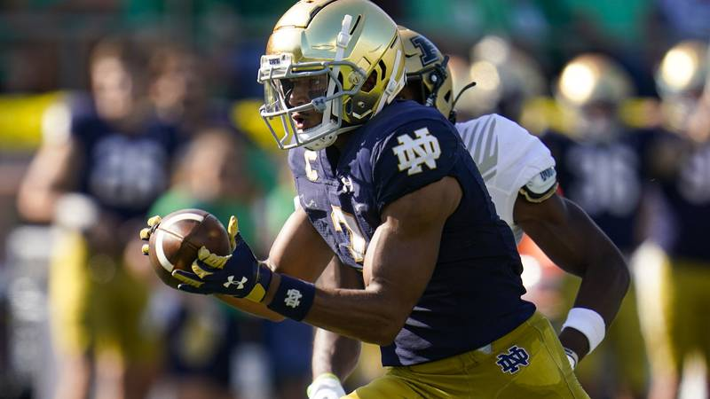 Notre Dame wide receiver Avery Davis (3) makes a catch on his way to a touchdown against Purdue...