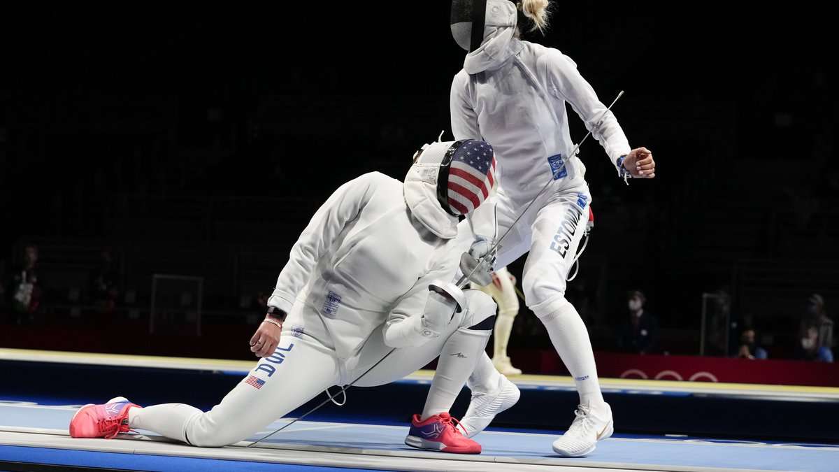 Kelley Hurley of the United States, left, and Erika Kirpu of Estonia compete in the women's...