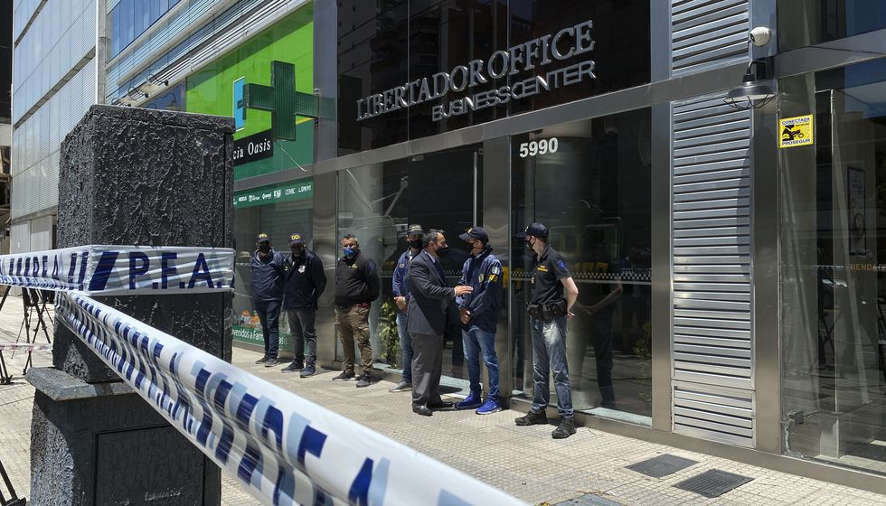Police guard the entrance to Dr. Leopoldo Luque's practice in Buenos Aires, Argentina, Sunday,...