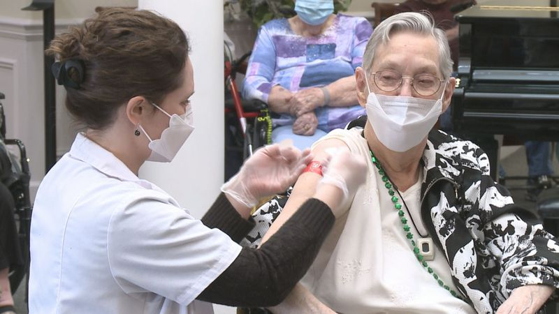 Nellie Yoder, 105, receives second dose of COVID-19 vaccine alongside Elkhart Mayor Rod Roberson.