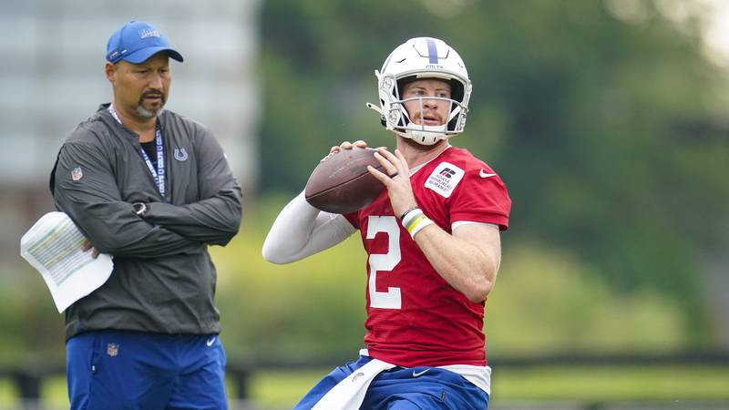 Indianapolis Colts quarterback Carson Wentz runs a drill during practice at the NFL team's...