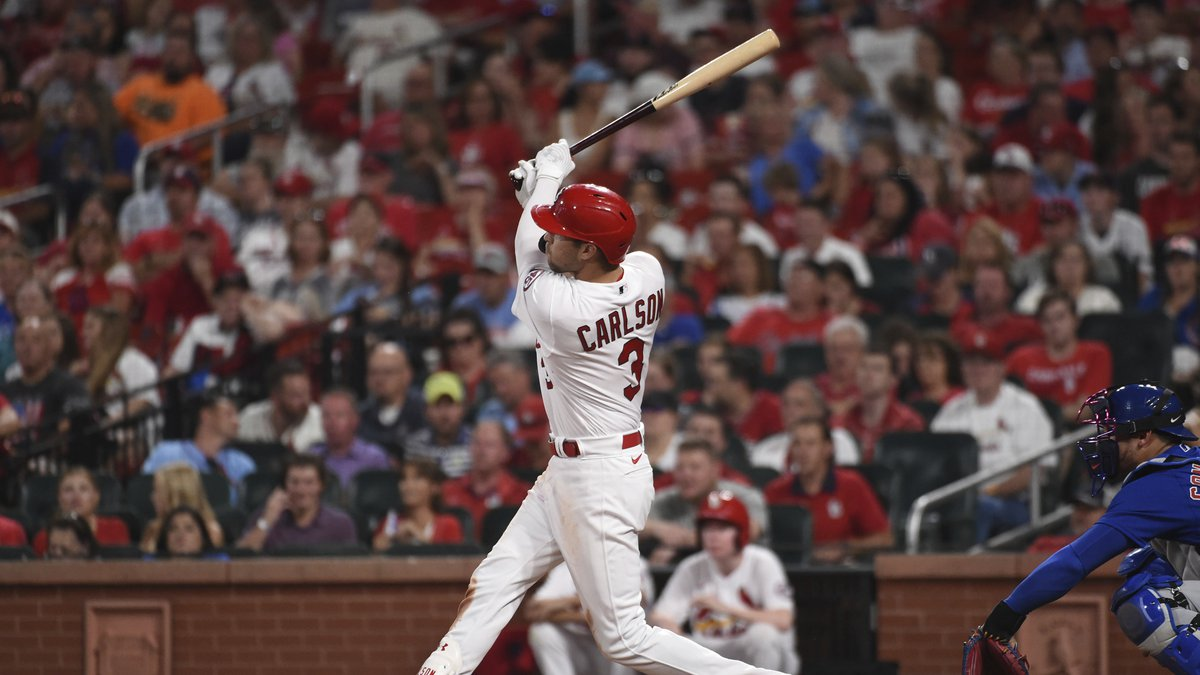 St. Louis Cardinals' Dylan Carlson watches his home run during the sixth inning of a baseball...
